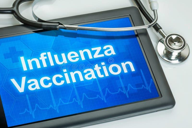 Tablet mit der Text Grippe-Schutzimpfung stockfoto