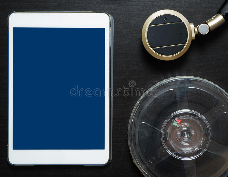 Tablet Movie Streaming Film and Headphone royalty free stock photo