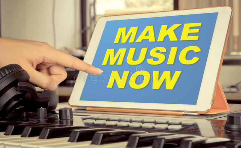 Tablet music producer touching application. Tablet music producer touching Tablet to start making Music now royalty free stock images