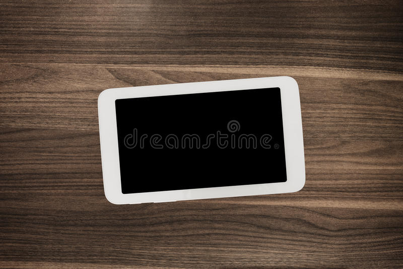 Tablet op houten bureaulijst royalty-vrije stock foto
