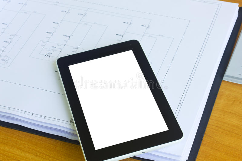Tablet over engineering diagram royalty free stock photo