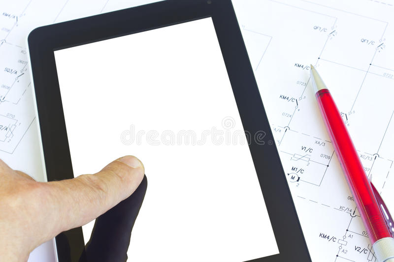 Tablet over engineering diagram stock photography