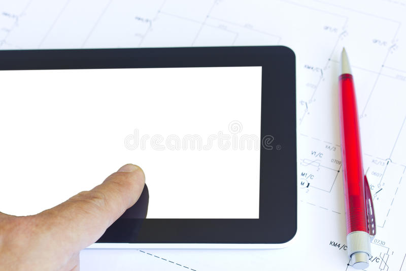 Tablet over engineering diagram royalty free stock image