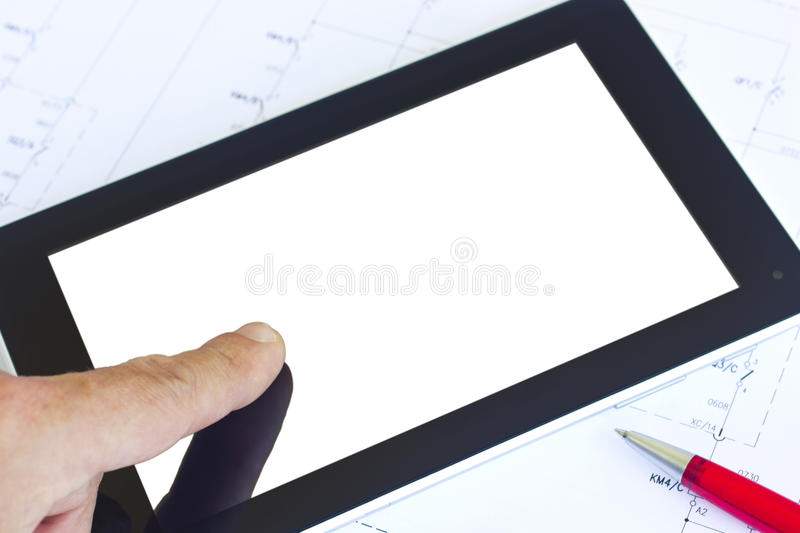 Tablet over engineering diagram royalty free stock photography