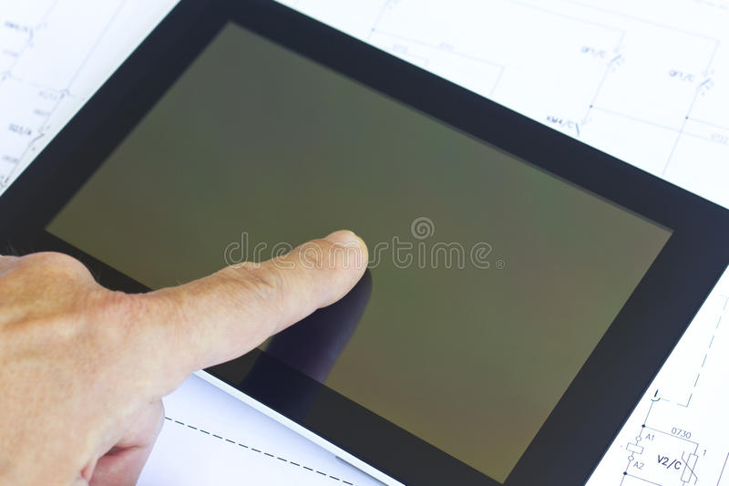Tablet over engineering diagram royalty free stock photos