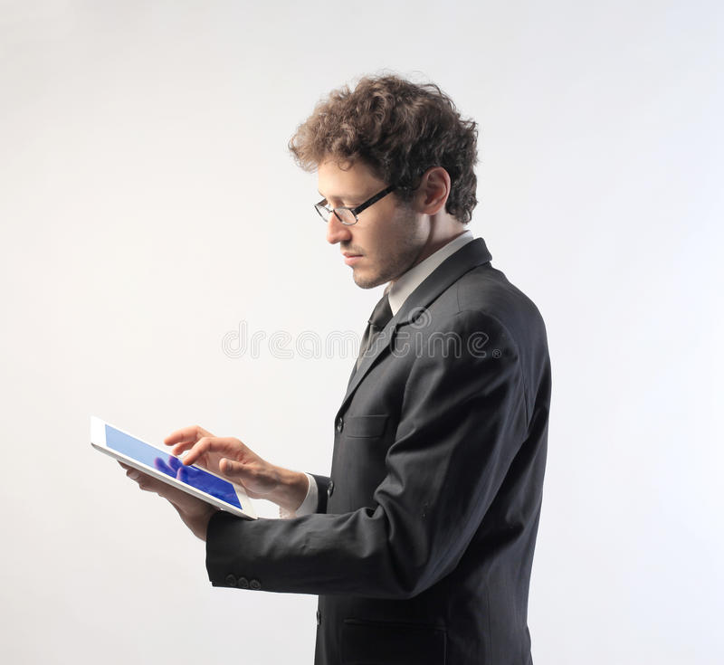 Tablet pc. Young businessman using a tablet pc