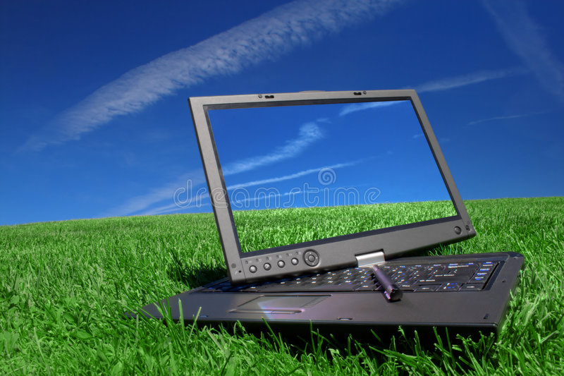 Tablet PC on green grass stock photos