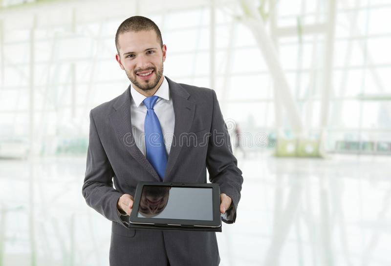 Tablet pc. Happy businessman with a tablet pc, at the office stock photo