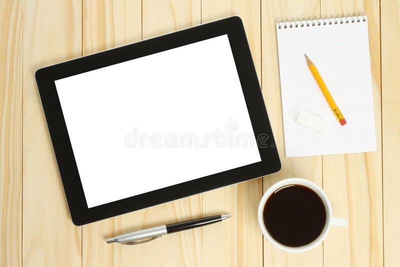 Tablet PC, taza de café con los materiales de oficina foto de archivo libre de regalías