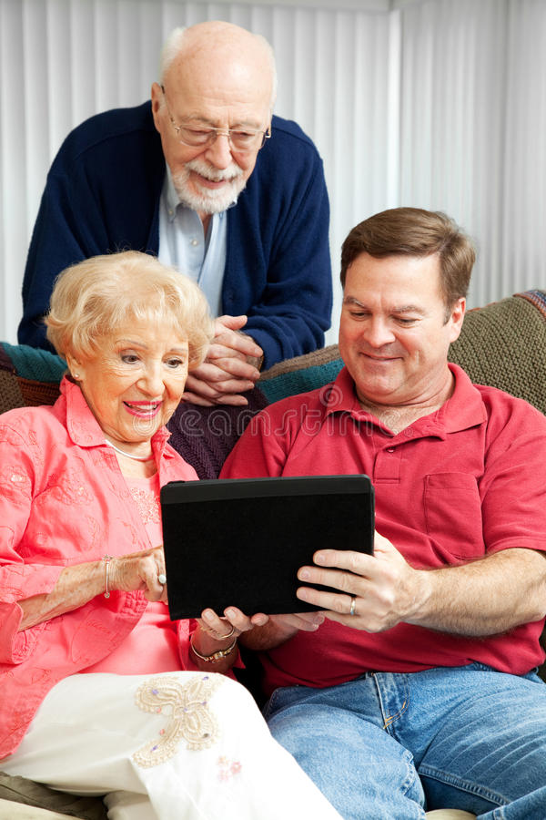 Download Tablet PC - Teaching Senior Parents Stock Image - Image: 25190957