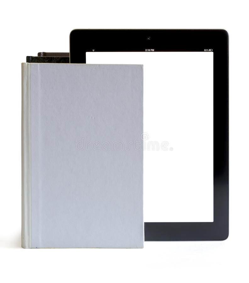 Download Tablet pc in to the books stock photo. Image of paper - 26561122