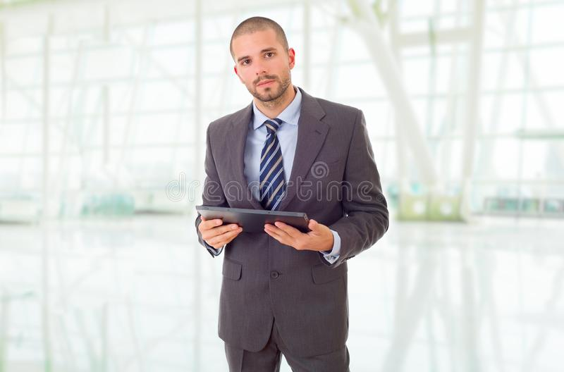 Tablet pc. Worried businessman with a tablet pc, at the office royalty free stock photos