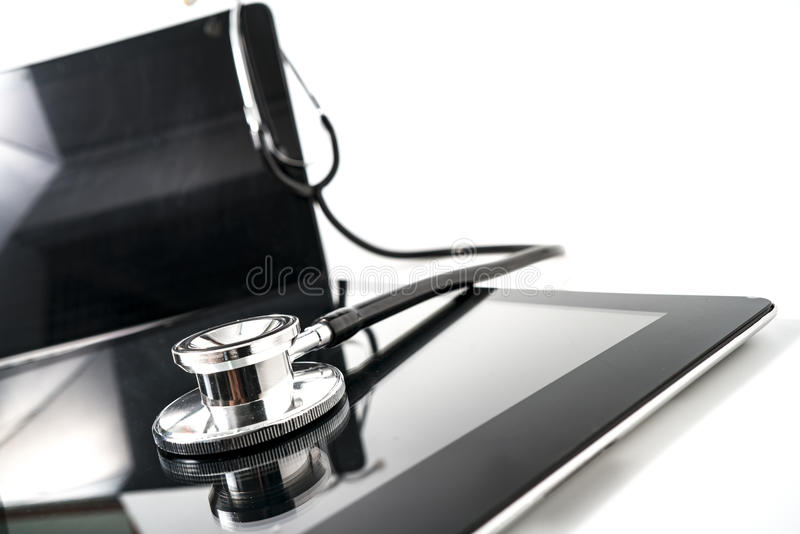 Tablet / Phablet being diagnosed by stethoscope - phone repair a royalty free stock photography