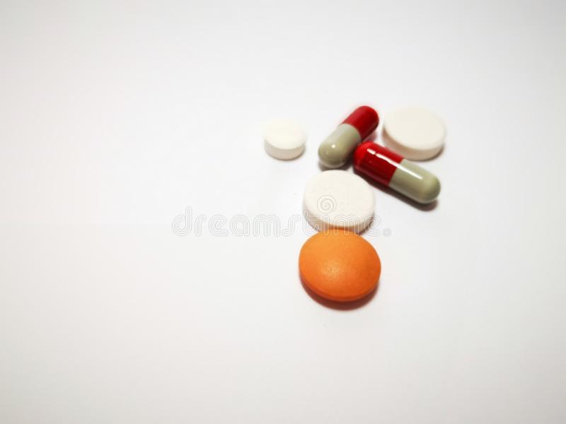 Closeup with tablets medicine from pharmacy. A tablet is a pharmaceutical dosage form. Tablets may be defined as the solid unit dosage form of medicament or royalty free stock images