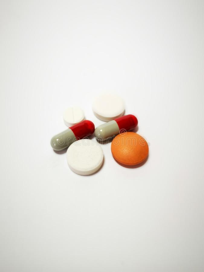 Closeup with tablets medicine from pharmacy. A tablet is a pharmaceutical dosage form. Tablets may be defined as the solid unit dosage form of medicament or stock image