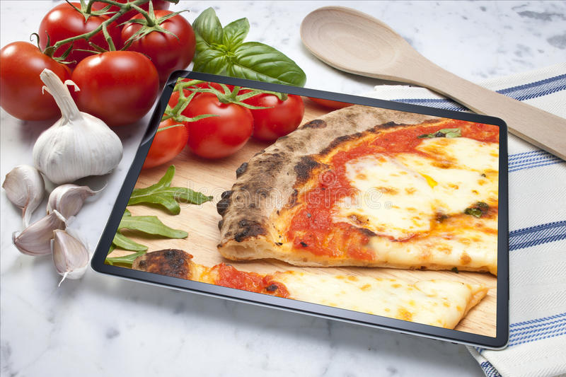 Tablet Pizza Background Food stock photo