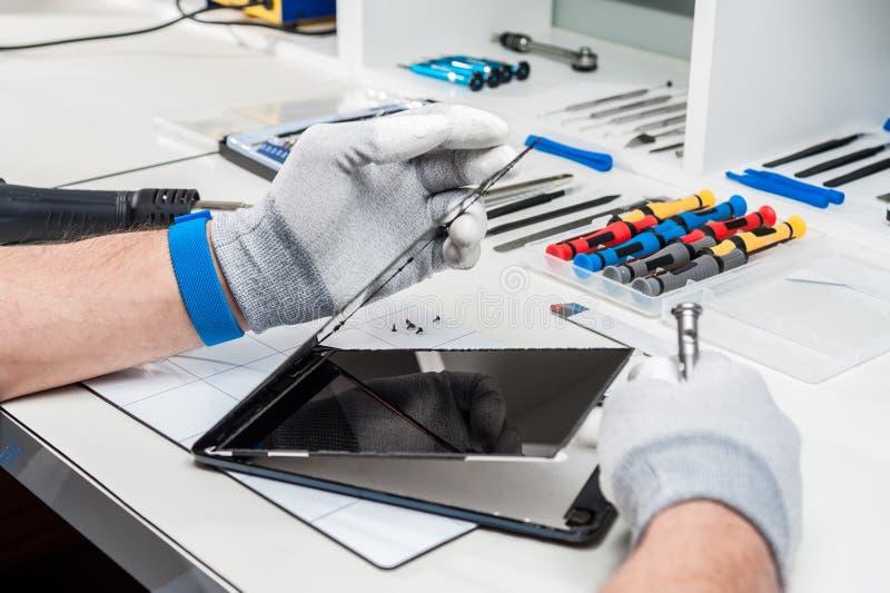 Tablet, pod repair royalty free stock photos