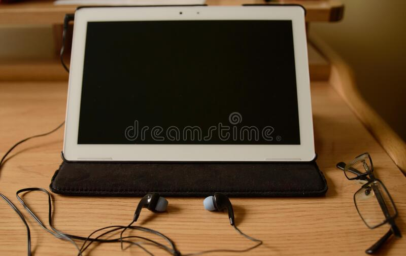 Tablet Prepared With Helmets To Make A Work Video Conference.  royalty free stock photography