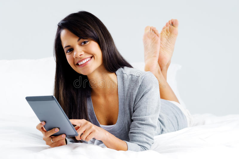 Tablet reading woman royalty free stock image