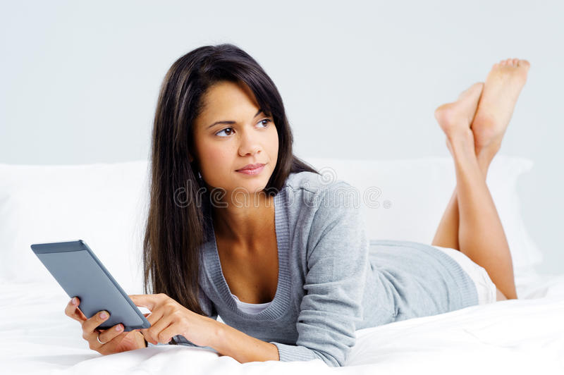 Tablet reading woman royalty free stock photography