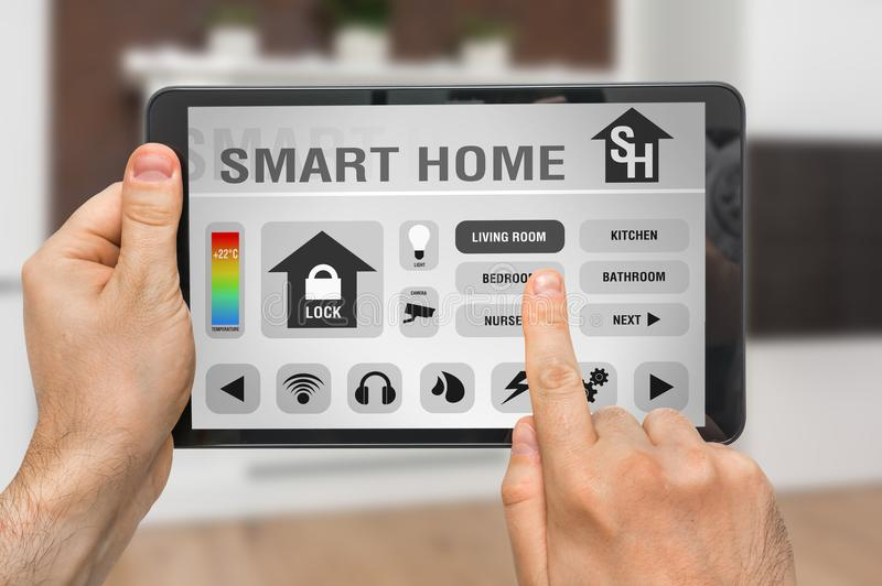 Tablet with remote smart home control system royalty free stock images