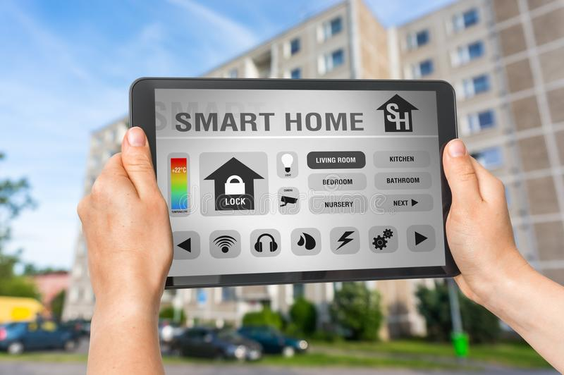 Tablet with remote smart home control system stock photography