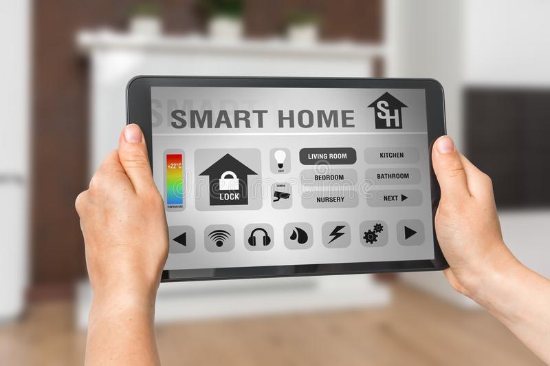 Tablet with remote smart home control system stock photo