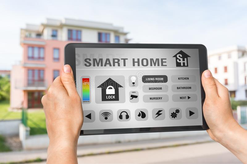 Tablet with remote smart home control system royalty free stock image