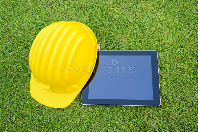 Download Tablet and Safety helmet stock image. Image of occupation - 28956771