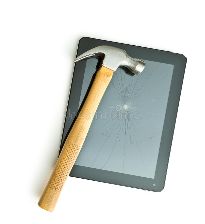 Tablet screen broken with a hammer. Isolated on white background royalty free stock photography