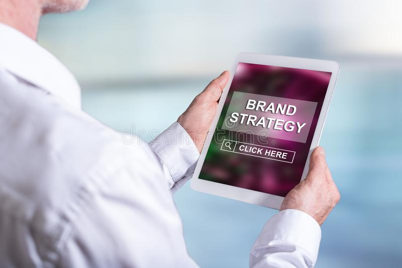Brand strategy concept on a tablet. Tablet screen displaying a brand strategy concept stock image