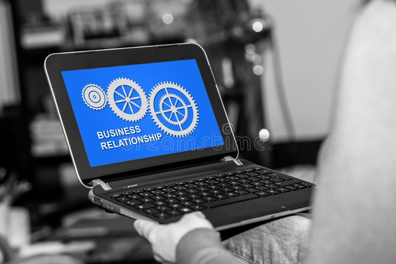 Business relationship concept on a tablet. Tablet screen displaying a business relationship concept royalty free stock photos