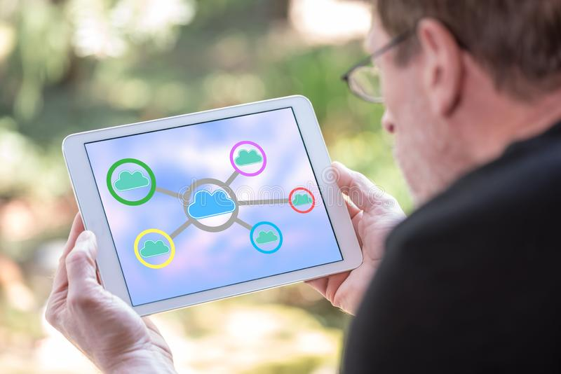Cloud networking concept on a tablet royalty free stock photo