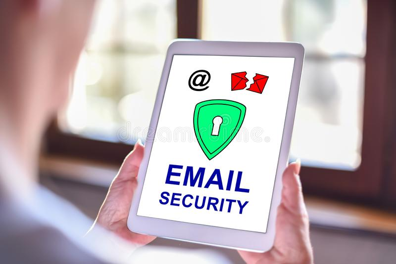 Email security concept on a tablet. Tablet screen displaying an email security concept stock images