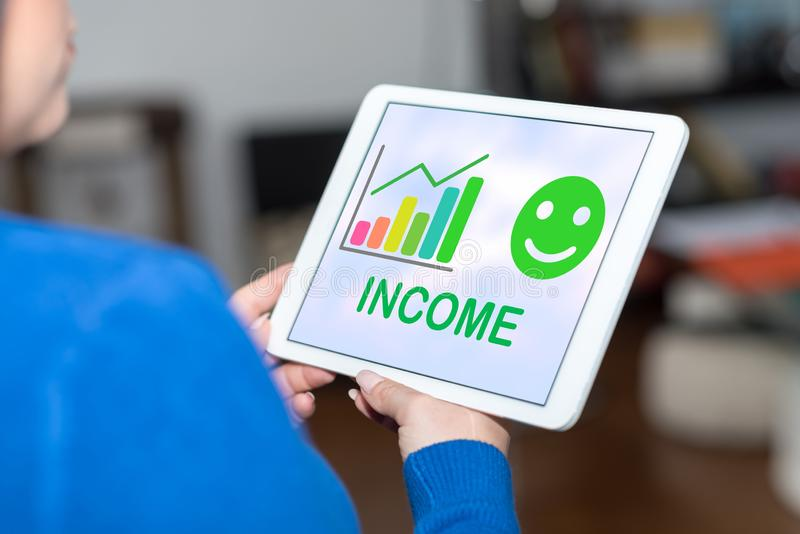 Income growth concept on a tablet. Tablet screen displaying an income growth concept stock image