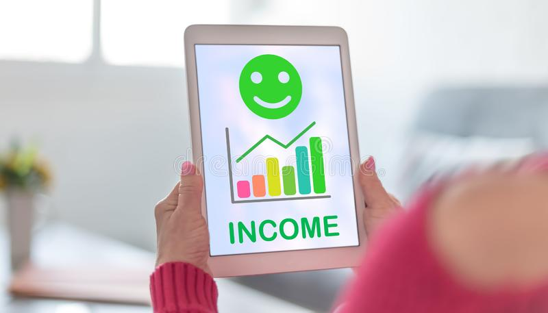 Income growth concept on a tablet. Tablet screen displaying an income growth concept royalty free stock image