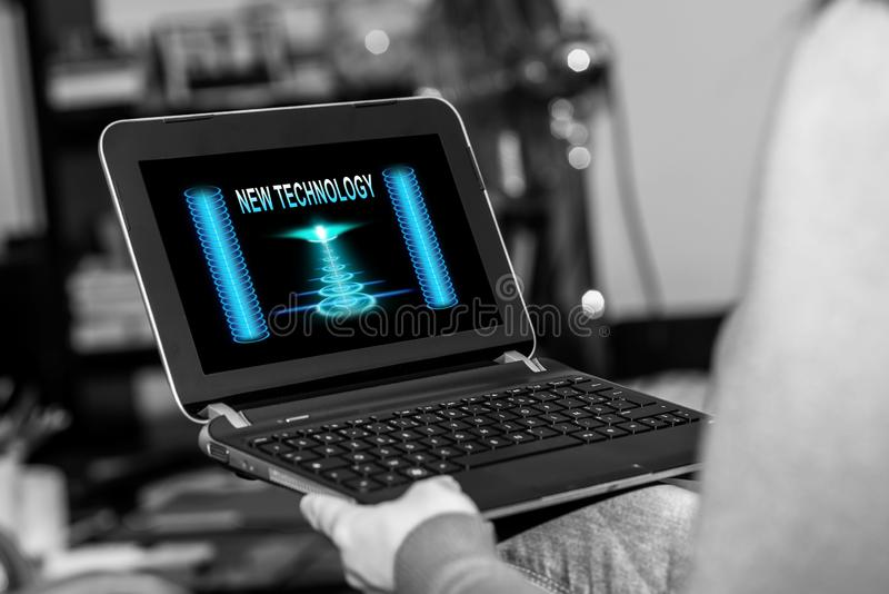 New technology concept on a tablet. Tablet screen displaying a new technology concept stock photography