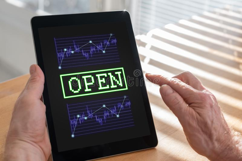 Open stock market concept on a tablet. Tablet screen displaying an open stock market concept royalty free stock photos