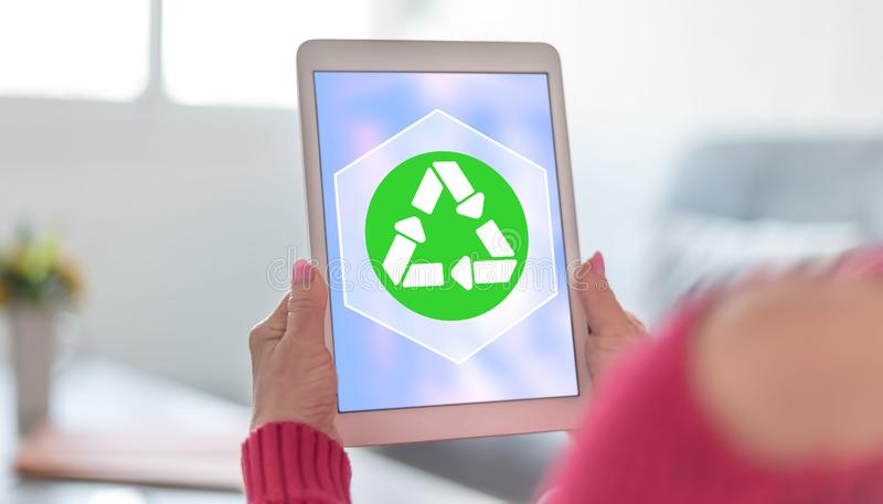 Recycling concept on a tablet royalty free stock photography