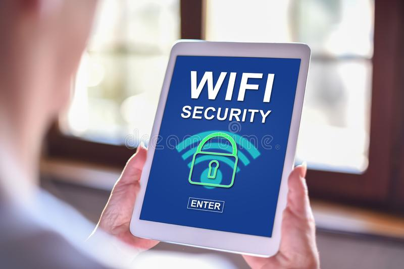 Wifi security concept on a tablet. Tablet screen displaying a wifi security concept royalty free stock photo