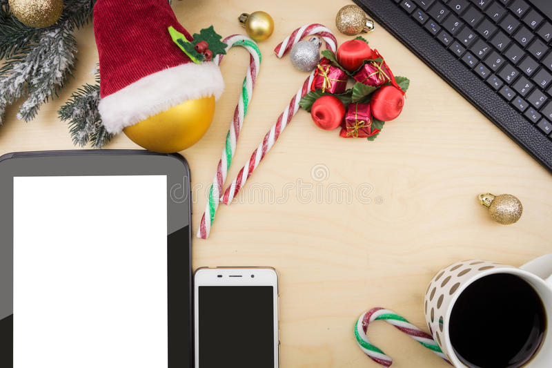 Tablet, smartphone and cup of coffee. With winter festive ornaments royalty free stock image