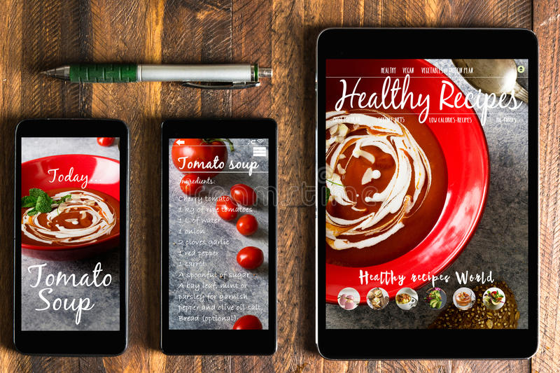 With tablet and smartphone healthy recipes blog on screen. Web o. N the screens of the devices royalty free stock photo