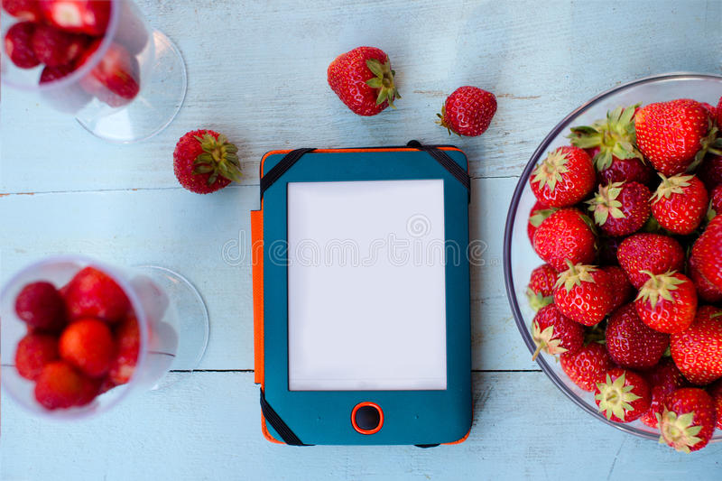 Tablet and strawberry stock image