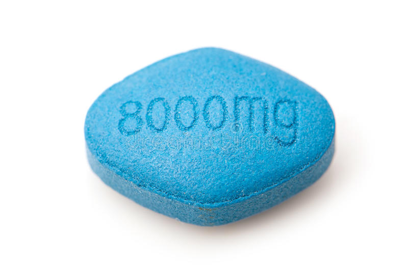 Tablet to treat erectile dysfunction. Blue generic tablet designed to treat erectile dysfunction inscribed with dose of eight thousand milligrams stock photography