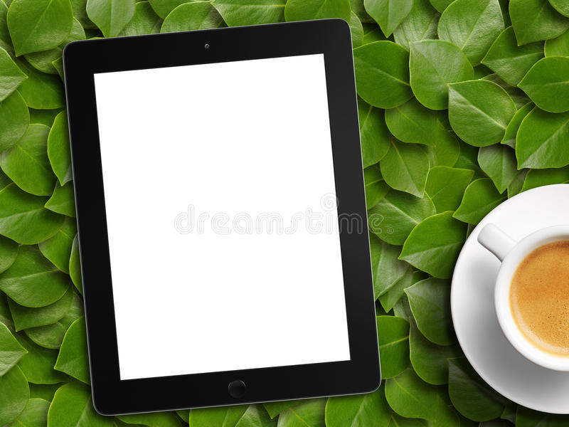 Tablet white screen similar to ipad display and coffee. On background royalty free stock images