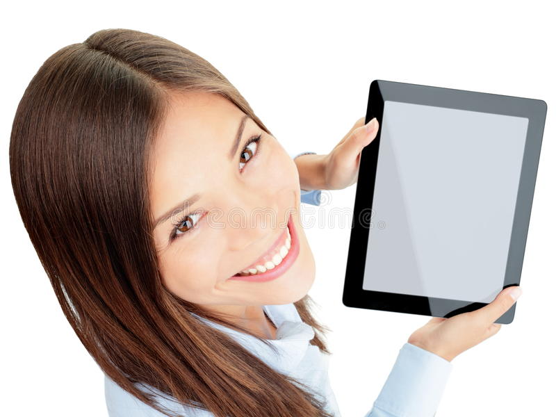 Tablet woman. Woman holding tablet computer touch pad with copy space isolated on white background. Beautiful mixed-race Asian Chinese / Caucasian female