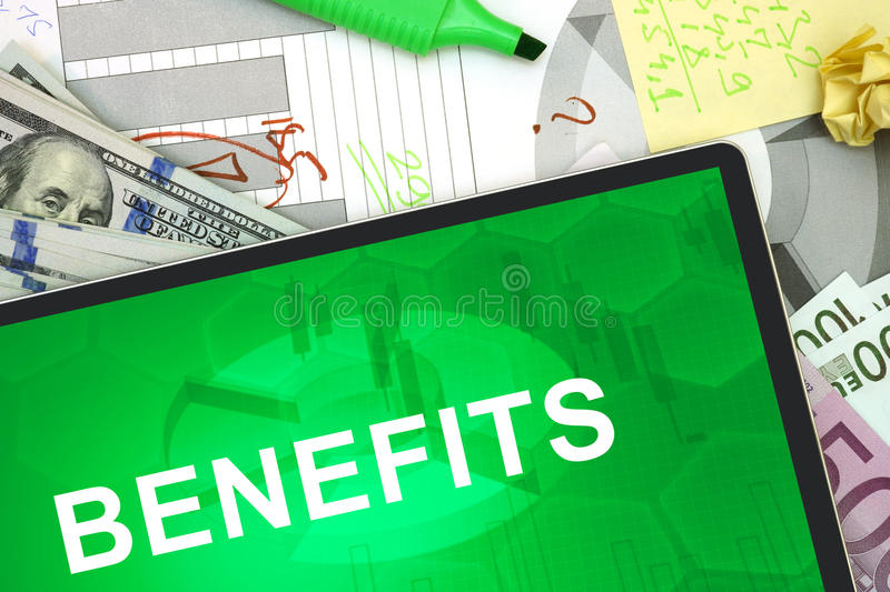 Tablet with words benefits royalty free stock photo