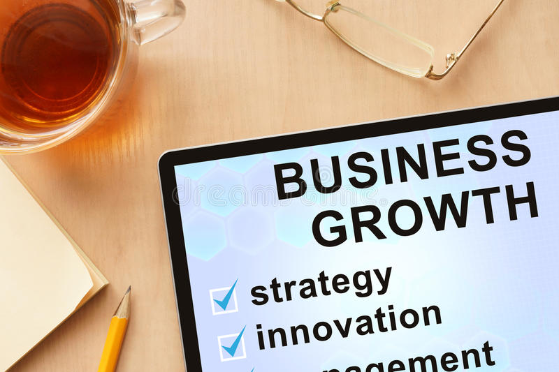 Tablet with words business growth. royalty free stock photo