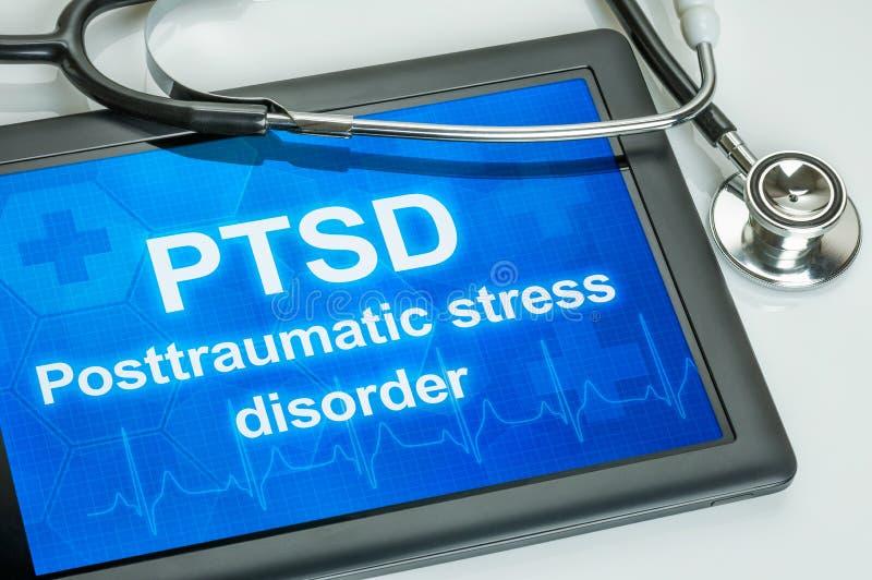 Tableta con el texto PTSD la exhibición foto de archivo