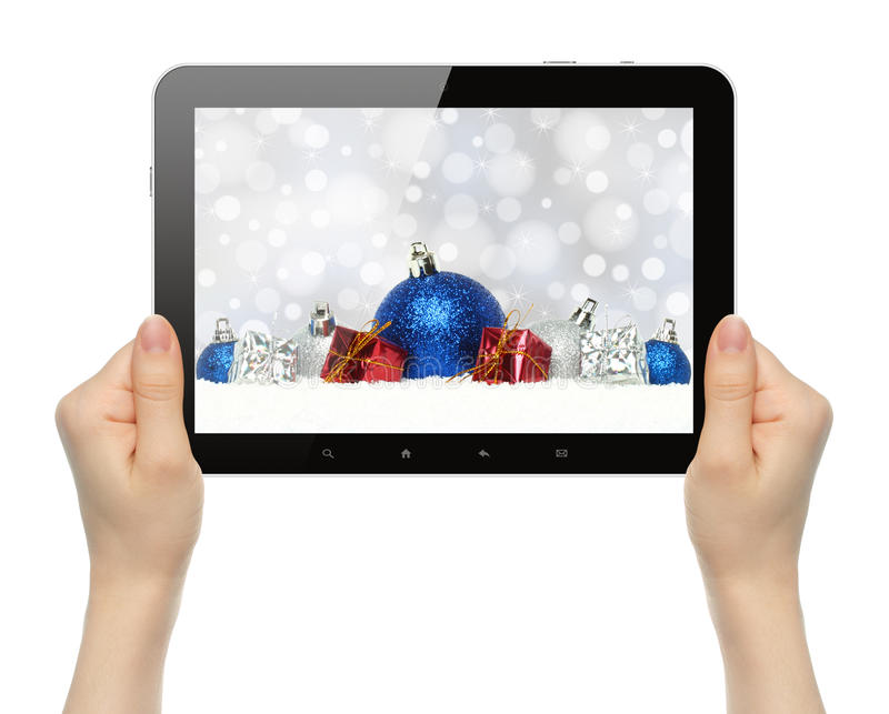 Tableta del control de las manos con la composición de la Navidad fotografía de archivo